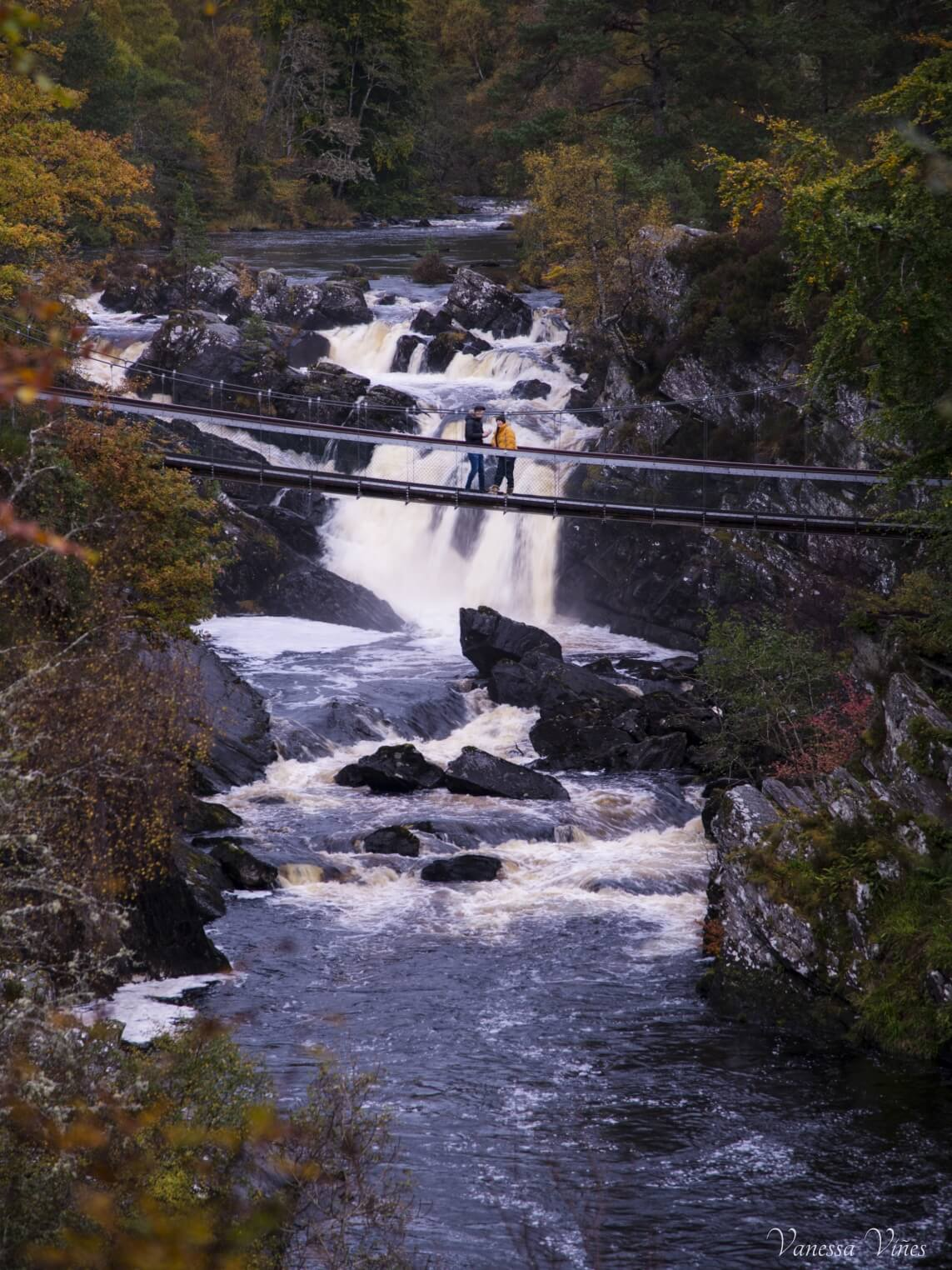 Crossing bridge in Rogie Falls